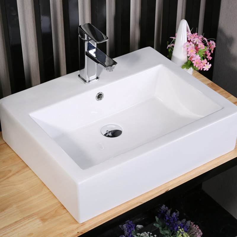 deposits can be stripped from porcelain sink, but toilet may be down the drain  -  bathroom sink with towel bar